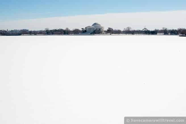This is looking directly across the Tidal Basin. Cold temperatures have frozen the Tidal Basin (and the Potomac), and fresh snowfall now covers the ice.